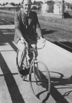 Cecil Norman on bicycle